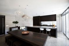 Awesome kitchen. Remove the lights, blinds. I would like to add more of a natural tone to this room also add a stove top and sink to the counter island.