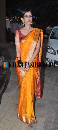 http://www.kalkifashion.com/ Niskha Lulla in a traditional orange, red saree attends Sameera Reddy's wedding