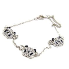 Fancy Silver Tone Black and Clear Rhinestone Paved Triple Panda Bracelet Anklet Animal Fashion Jewelry World Pride. $2.99. Adjustable length 21cm to 26cm. Panda decoration size: apporx 1.2*1cm. Made of alloy. With rhinestones paved on panda