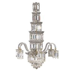 VICTORIAN CUT GLASS SIX-LIGHT WATERFALL CHANDELIER, ATTRIBUTED TO F. & C. OSLER MID 19TH CENTURY with five graduated circular tiers of lustres, issuing six scrolling arms hung with further lustres, above a graduated tier base hung with further prism drops