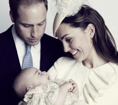 Prince George beams at Kate as their eyes meet, and William looks on proudly.