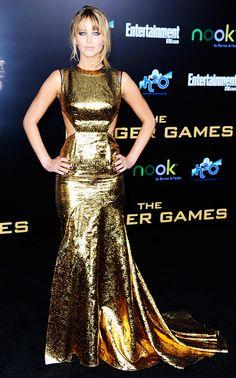 Jennifer Lawrence wears a gold cutout gown by Prabal Gurung