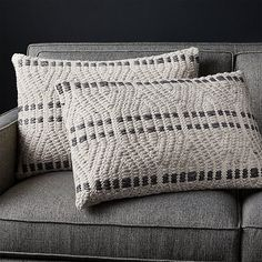 Sale ends soon. Shop Elma Black Stripe Pillows Set of Black and neutral natural fibers stitch a raised pattern of angular lines intersected by rows of dashes. Handwoven cotton and wool richly texture two exceptionally touchable lumbar pillows.