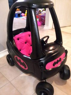 Pink Batmobile!  Cushion upholstered seat with gem buttons, and a bat license plate on the back.   More pictures:  http://imgur.com/a/r3vs5