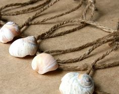 Some ideas on how to hang shells...isn't that ironic, a friend just gave me a bag of this rope