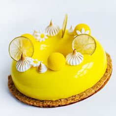 One more view of this bright cake Cake Citrus Splash  Composition: almond streusel pistachio Joconde sponge mandarin jelly with vanilla lemon cream light lemon mousse mirror glaze. Decor - Italian meringue lemon chips mousse sphere covered with chocolate velvet sugar paste flowers by moi_natalie