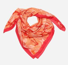 A wild addition to any outfit, this 100% silk scarf is printed in a fierce mix of fashionable camouflage and animal prints. The bright shades of pinky red and orange will bring a beautiful burst of colour and pattern to your wardrobe.  From the Tiger Safari Collection