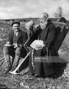 Brother Martin, a Franciscan friar, who is working on a water-bearing ridge on the Wolds, with the help of one labourer, (left), during their lunch break. They are laying a pipeline and constructing a reservoir to increase the water supply to the largest Roman Catholic College in the East Midlands.