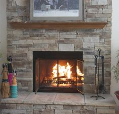 Free Stone Fireplace Design Ideas | Updating a brick fireplace to a stone fireplace for your formal, traditional, transitional, rustic, or contemporary room for Crystal  Lake IL