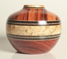 Brazilian tulipwood / black ash burl / book-matched wenge  about 2-3/8 inches diameter by 2 inches high Made by Jim McPhail