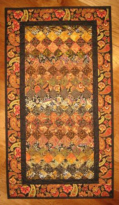 Black and Gold Paisley Art Quilt Kashmir Rug by TahoeQuilts