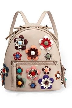 """This 'Zaino' backpack is part of Fendi's """"feminine yet never too girly"""" 'Flowerland' collection. It's made from smooth taupe leather and appliquéd with leather and python flowers in an array of sizes and colors. Attach your favorite bag charm to the front D-ring embellishment."""
