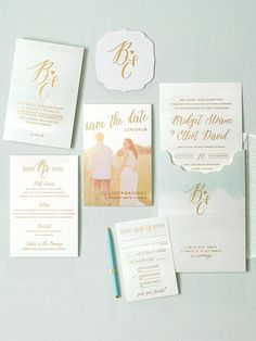 Put your engagement photos to good use! A dreamy save-the-date sets the tone for a subtle watercolor design, while two lines from an E. E. Cummings poem in gold foil effortlessly tie in to the suite.