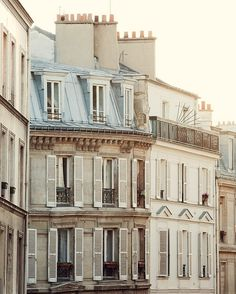 Parisian townhouse exterior. Beautiful shutters and moldings.