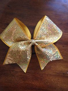 Gold Cheer bow by AnnieBowBannieBows on Etsy, $10.00