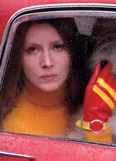 red car....Fashion photograph by Saul Leiter, 1966