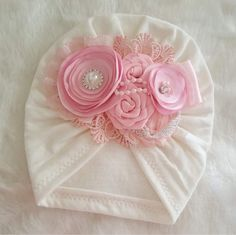 This turban is a stunner! It features a combination ivory in soft pink flowers accented with beautiful rhinestones and pearls. turban made of soft fabric Perfect for newborns, toddlers and young girls! *This sweet turban design is perfect for Fabric Flower Headbands, Diy Baby Headbands, Fabric Flowers, Pink Flowers, Baby Turban, Creation Couture, Diy Dress, Baby Girl Dresses, Baby Sewing