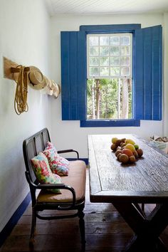 white walls, peacock blue shutters, wood farm table, antique rattan settee, and natural wood floors. Home Living, Living Spaces, Interior Inspiration, Design Inspiration, Blue Shutters, Indoor Shutters, Interior And Exterior, Interior Design, Interior Shutters