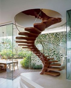 These stairs remind me of a fireman's pole but with a really unique spin on it.  The spiral stairs create a curved diagonal line that allows the eye to be carried up towards the circular cutout.