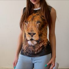 t o p 🔹NEW without tags 🔹Made in the US🇺🇸 🔹Fit: slightly longer in the back as shown in the second picture 🔹Not sure about the material but feels soft and stretchy like great quality spandex 🔹This shirt is fierce!!!🦁 I own one and get lots of compliments :) Tops