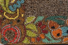 Detail from the embroidery on a 1920's Art Deco beaded bag. Lovely color combination...