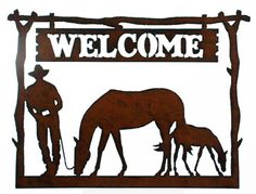 "Western Home Decor Welcome Sign Cowboy Mare and Foal 14.5"" Wide 18 gauge Steel in rustic finish Plasma cut to produce distressed edges Cowboy and Horses Made in USA"
