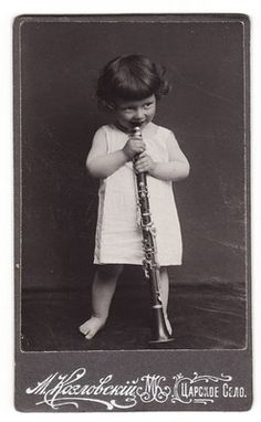 1900s Imperial Russia - Beautiful  Curly Baby Girl with Clarinet . CDV photo.