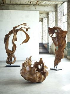 These are mahogany roots from long-ago felled trees that are sculpted to look as if they are fabric blowing in the wind. These are colossal sculptures that are one-of-a-kind and tell a story of sustainability. Each piece takes an artisan over 6 weeks to complete. See more at www.phillipscollection.com