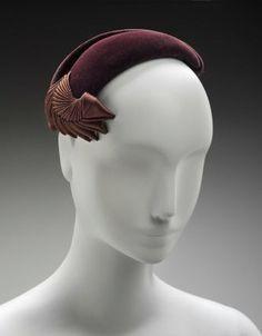 American, 1950–59. Designed by Hattie Carnegie, American (born in Austria), 1889–1956. Retailed by Filenes Department Store, Boston. Dimensions Overall (height x diameter): 7.6 x 21.6 cm (3 x 8 1/2 in.)Medium or Technique - Fur felt, silk satin ribbon, grosgrain ribbon, elastic, plastic combs.