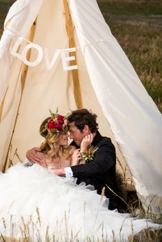 Bride and Groom in wedding teepee - Reign Magazine