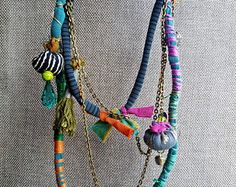 Items similar to Colorful Multi strand Necklace Eco Friendly Necklace Textile Necklace Fabric Necklace African Style Recycle Fabric Necklace OOAK on Etsy Textile Jewelry, Fabric Jewelry, Boho Jewelry, Jewelry Crafts, Jewelry Art, Jewelery, Handmade Jewelry, Jewelry Design, Etsy Jewelry