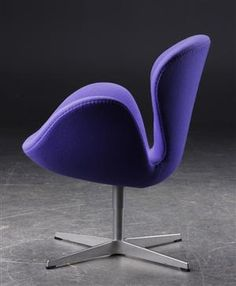 Arne Jacobsen, The Swan, lounge chair, model 3320, seat shell upholstered in lavender-coloured wool, swivel four-star aluminium. Designed 1957-1958 for the Hotel Royal in Copenhagen. Produced by Fritz Hansen. Literature: C. Thau & K. Vindum, 'Arne Jacobsen'. Discussed and reproduced p. 469.