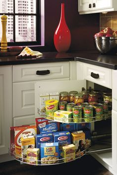 This blind corner cabinet has wire shelving that pulls beyond the cabinet, bringing items right to your fingertips.