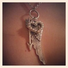 Hungergames inspired find. Necklace with a wing, arrow and pearl heart.