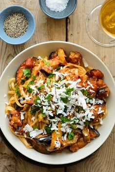 This traditional Sicilian pasta dish of sautéed eggplant tossed with tomato sauce and topped with ricotta salata makes for a satisfying vegetarian dinner, and it can be thrown together in under an hour. (Photo: Sabra Krock for The New York Times) http://nyti.ms/2mtG10M