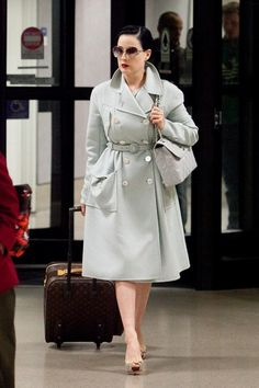 Dita Von Teese...this is something I'd like to wear traveling, chic but comfortable