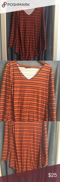 Dress This is a cotton stretchy dress. It's very soft. The colors are dark orange and dark blue. Long sleeves. Brand new never worn. Dresses