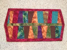 Whimsical table runner made from scraps!