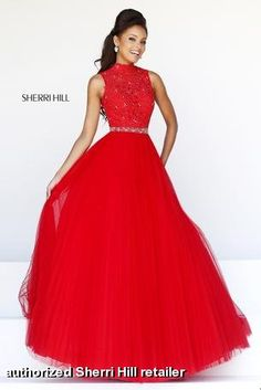 Prom dress by Sherri Hill 21334. This stunning unique long prom gown has a lace bodice with a sheer high halter neckline. The back bodice ha...