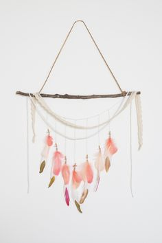 handmade with love & light: wood branch // suede // white + rose gold beads // painted white feathers // pink + coral goose feathers // lace // silver sequins.