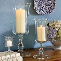 Center pieces. D.I.Y Hurricane Vases. Candlestick holders/Vases @$1 store. Gorilla Glue candlestick rim to vase = Hurricane Vase.