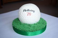 This is the golf ball cake I made for my father in law's birthday. The grass (extruded from my sugar shaper gun) was fun to do, and it hides the not perfectly round bottom bit of the golf ball nicely. I sprayed the ball with glaze to make it shiny (because that's what golf balls look like, right?), and nearly cried when my hand painted lettering started to run. Luckily, I managed to salvage things using what I have discovered to be the edible form of tippex - super white dust mixed with gin.