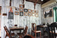 "Parlor style photographs on wall. Buy used frames at a flea market. Have local artists contribute/provide the photos. I could do the first batch of photos and then you could do a ""call for entries"" to get locals involved in the next round. Put an artists work up for a given amount of time. They could put prices and be available to sell."