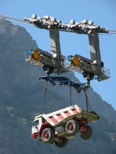 Home Discover Dump truck hanging on chains held by tower crane boom in mountainous construction location. Dump Trucks, Cool Trucks, Big Trucks, Mining Equipment, Heavy Equipment, Monster Trucks, Construction Machines, Road Construction, Heavy Machinery