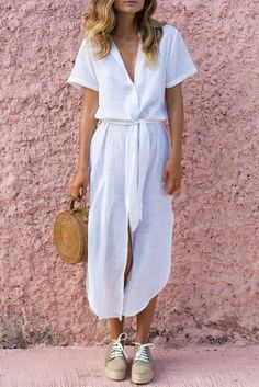 When you pretend to be Parisian for a day. This is a button-up, ready to wear dress that ties at the waist. Perfect over your swimsuit this Summer.  Relaxed fit