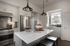 With a functional triangle layout, beautiful modern cabinetry and some luxurious add-ons, this neutral kitchen is one of the best rooms in the house.