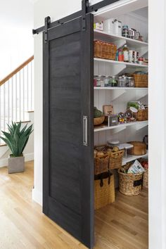 Farmhouse Kitchen Ideas This is my dream kitchen pantry. It is stunning, I love the black barn door. - Own Kitchen Pantry Decor, House, Modern Country Kitchens, Home Furnishings, Modern Light Fixtures, Country Kitchen, Storage, Furnishings, Household Decor
