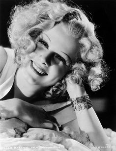 Smiling Jean Harlow via Iconista on Flickr. Black and white, vintage photograph. Starlet, actress, movies, cinema, celebrity faces. Thin eyebrows, high cheekbones, blonde woman, blond, curls.