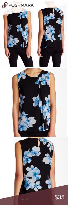 """Calvin Klein Floral Chiffon Overlay Tank S New with tags. Size S.   Details: A draped pleat accents the left of a sleeveless double layer top with blue scale blossoms. - Crew neck - Sleeveless - Back button keyhole closure - Approx. 25"""" length - Imported Fiber Content: Shell 1: 100% polyester Shell 2: 95% rayon, 5% spandex Care: Dry clean only Additional Info: Fit: this style fits true to size.  Model's stats for sizing: - Height: 5'9.5"""" - Bust: 32"""" - Waist: 24.5"""" - Hips: 35"""" Model is…"""