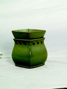 """In the Fall/Winter 2006 Catalog, Scentsy introduced """"Scentsy Green"""" the first warmer inspired and designed by Heidi Thompson"""